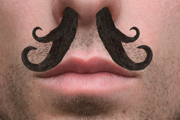 man with long curly nose hair sticking out of his nose