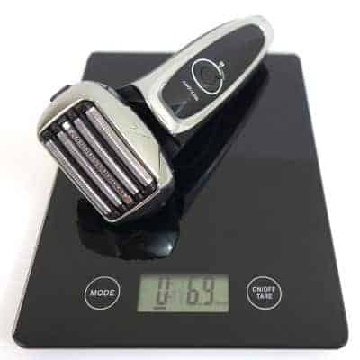 Panasonic Arc5 5-blade Electric shaver weighed on digital scales