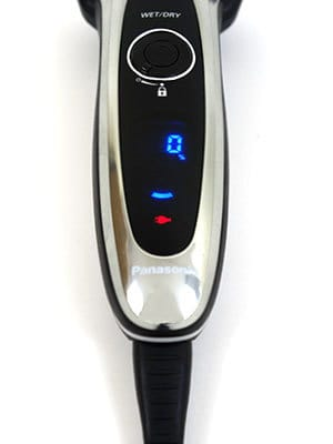 Panasonic Arc5 5-blade Electric Shaver with charger plugged in and display screen turned on