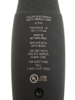 Philips Norelco 7300 electric shaver (7000 series) specifications printed on rear of body