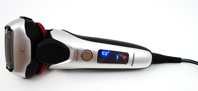 Panasonic Arc 3 electric shaver with charging cord plugged in