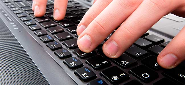 Fingers typing an email