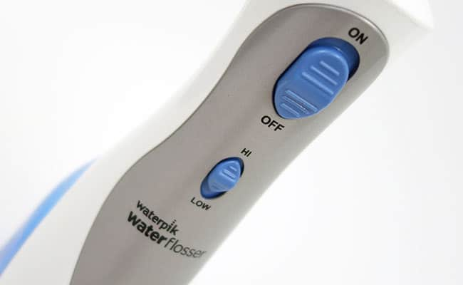 Waterpik Cordless Plus controls on/off and pressure buttons