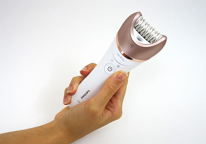 Philips Satinelle Prestige epilator held in right hand