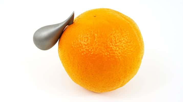 Alessi Apostraphe citrus peeler peeling the skin of an orange