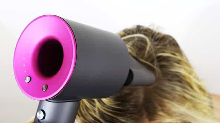 Dyson Supersonic hair dryer blow drying top of head