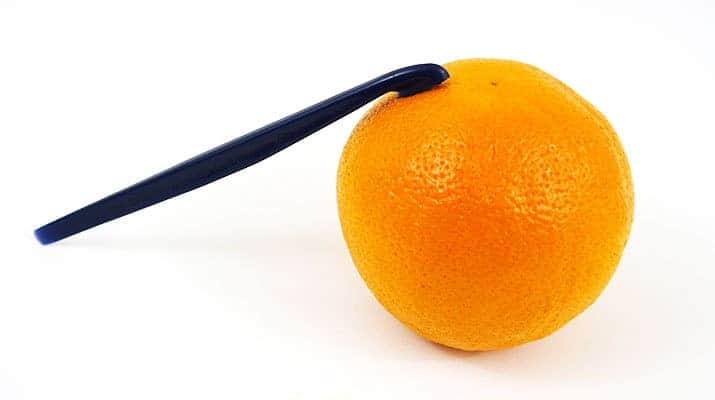 Tupperware citrus peeler peeling the skin of an orange