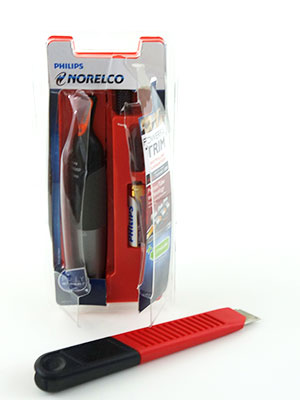 Philips Norelco 3200 NoseTrimmer Packaging sliced open with retractable knife