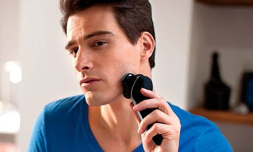 Brunette Male shaving beard with Philips Norelco S9311/84 9300 electric shaver (9000 series)