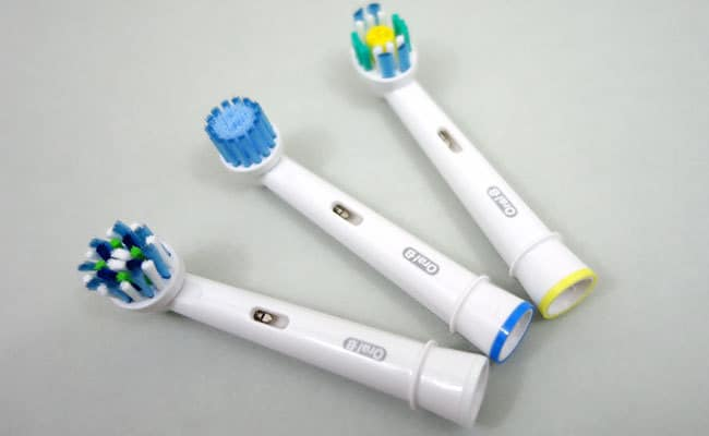 Oral-B Sensitive Pro-White and crossaction brush heads included with white 7000