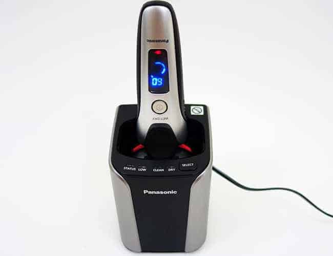 Panasonic Arc 3 electric shaver charging while sitting in cleaning station