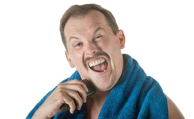 Man shaving with electric shaver break in period