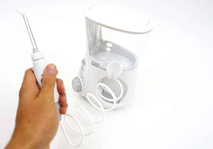 Waterpik Aquarius Professional Water Flosser handle held in right hand