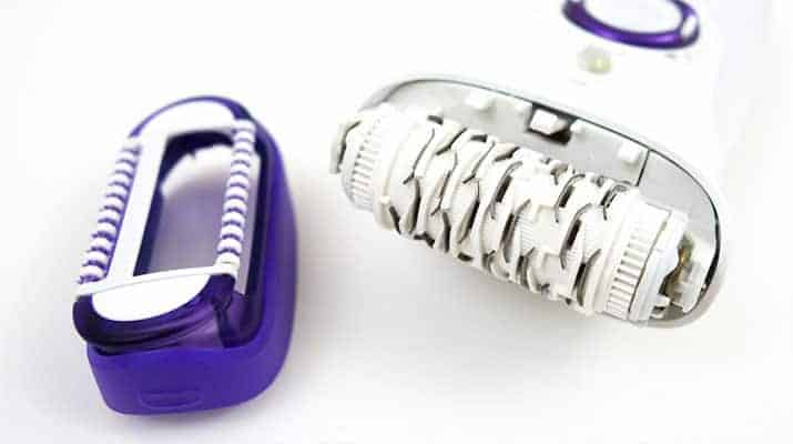 Braun Silk Epil 9 epilator with massage cap removed and epilation head exposed