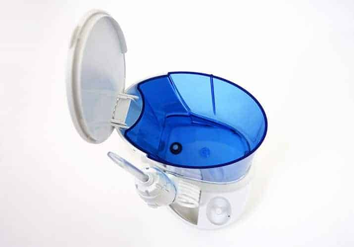 Waterpik Complete Care 5.0 with lid open revealing reservoir