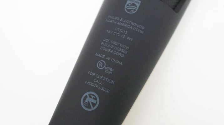 Philips Norelco Series 7000 7200 Vacuum Beard Trimmer specifications printed on rear of handle